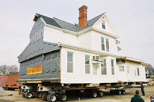 The Alexander Black House as it was being moved to its current location on Draper Road. Its conversion to a funeral home left the exterior signifigantly different from its original appearance. Photo obtained from blacksburg.gov.