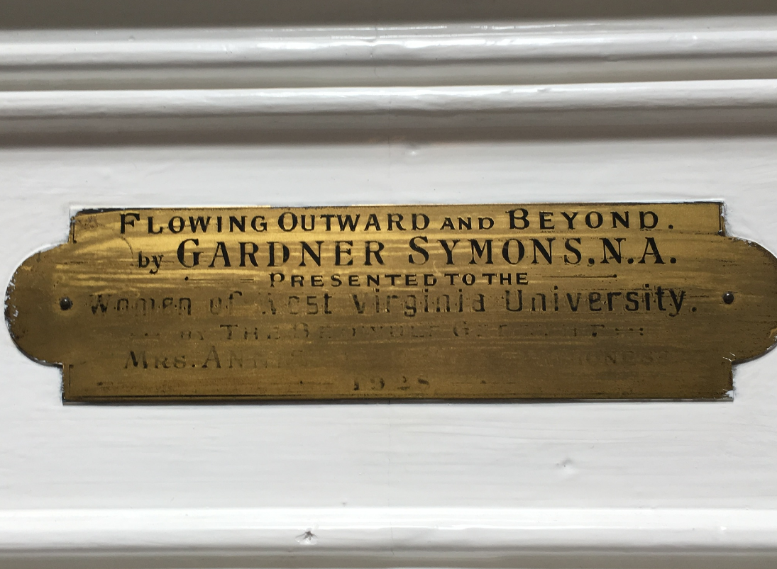 "Dedication plaque for George Gardner Symon's ""Flowing Outward and Beyond,"" on display in the lobby of Elizabeth Moore Hall"