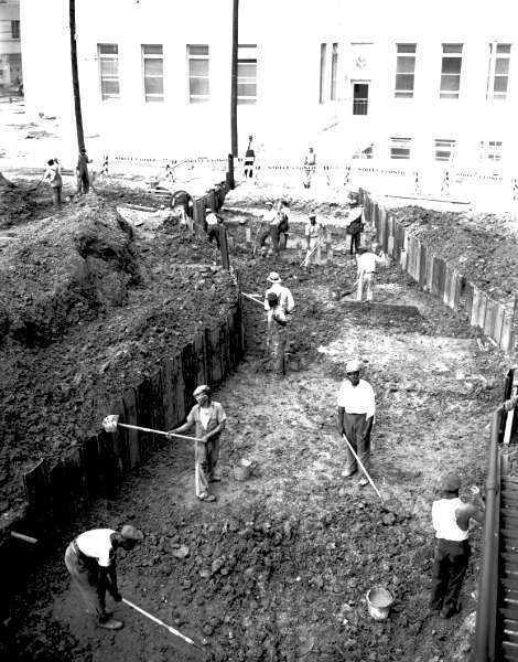 Tunnel and Foundation of the New Charity Hospital: WPA workers laying the foundation and making the tunnel on LaSalle Street. 