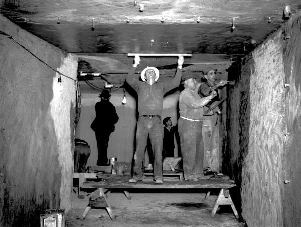 Tunnel, beneath Lasalle Street: WPA workers completing the tunnel connecting Hutchinson Memorial to Charity Hospital. The passage way is approximately 150 ft. long and 10 ft., and it was used to connect the LSU medical school and the hospital. Courtesy of