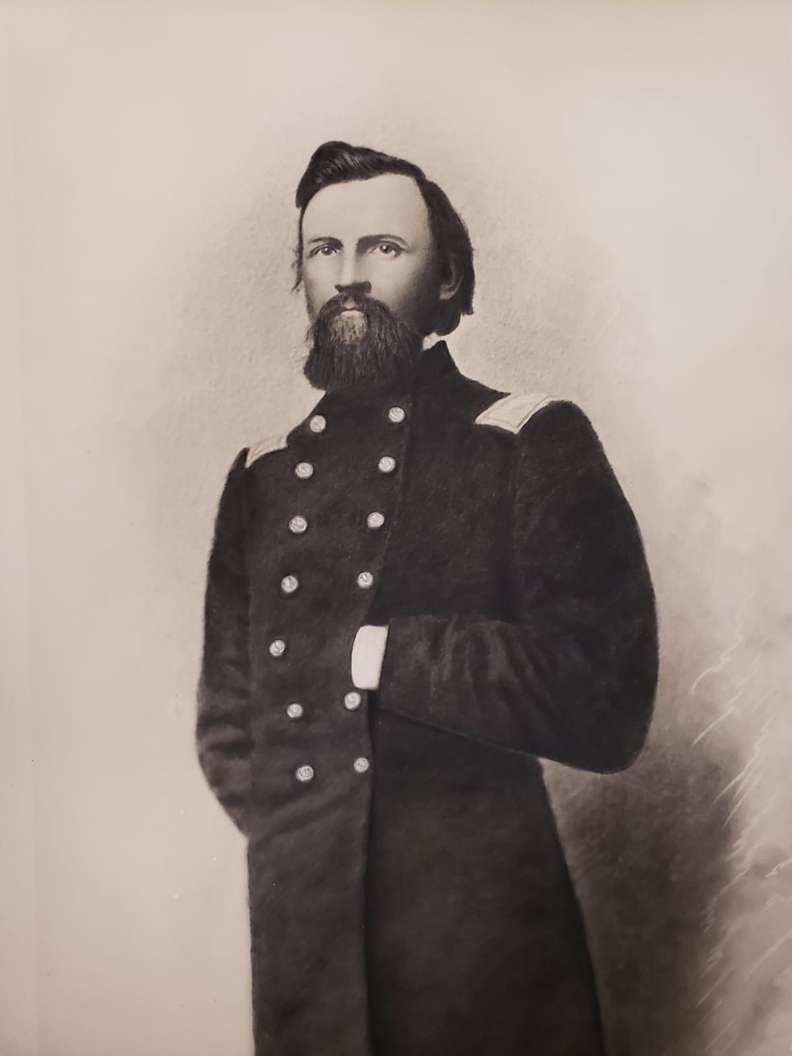 Large charcoal portrait of Hans C. Heg, the colonel of the 15th Wisconsin Infantry Regiment during the Civil War and a prominent state politician prior to the war. The portrait shows a bearded Heg in full Union uniform with his right hand behind his back and his left hand in the front of his coat.