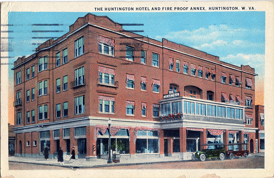 The Hotel Huntington, featuring a glass-enclosed balcony over its entrance