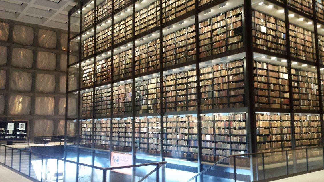 Inside the Beinecke: the space is partially lit by natural light filtering through the marble walls. (source: Burt Westermeier)