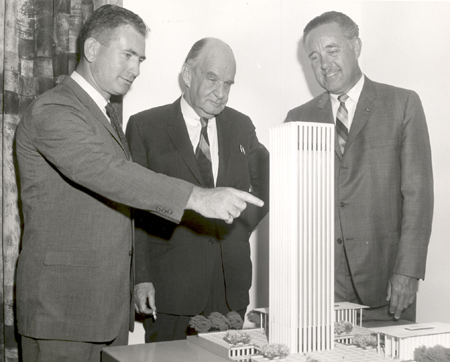 Model of Electronics Research Centers first phase of construction is examined by Dr. Albert J. Kelley, Deputy Director; Edward Durell Stone (center), architect, and Dr. Winston E. Kock, Director. Courtesy of NASA