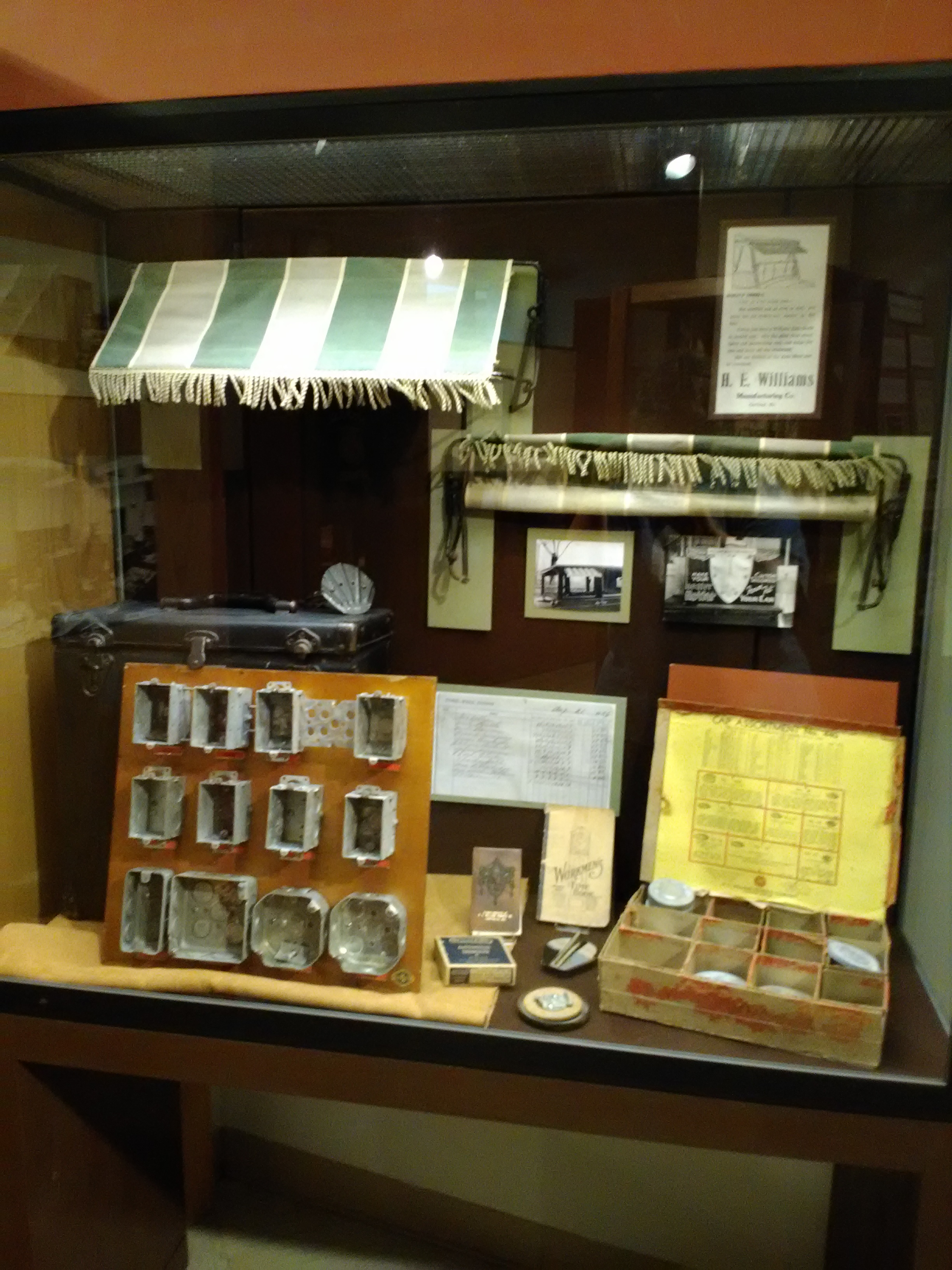 2017  Display on H. E. Williams, Inc., showing early auto and lighting products made during 1920s-1940s. H. E. Williams, Inc., was the museum's 2017 Exhibit Gallery Sponsor.