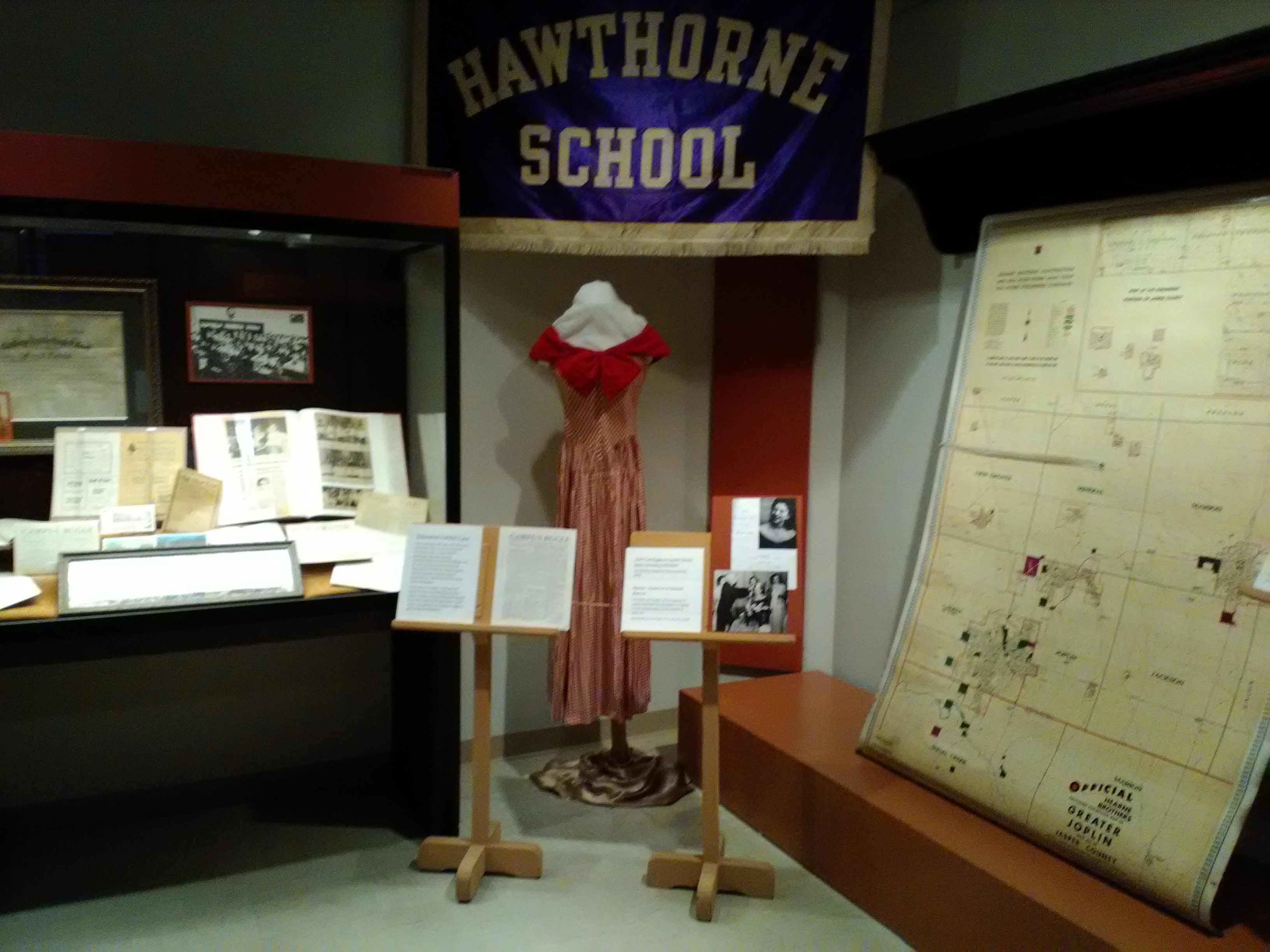 2017  Display of Carthage, Missouri, public schools within the larger 175th Anniversary of Carthage 2017 exhibit. The purple banner is from the former Hawthorne School located on West Central Avenue.