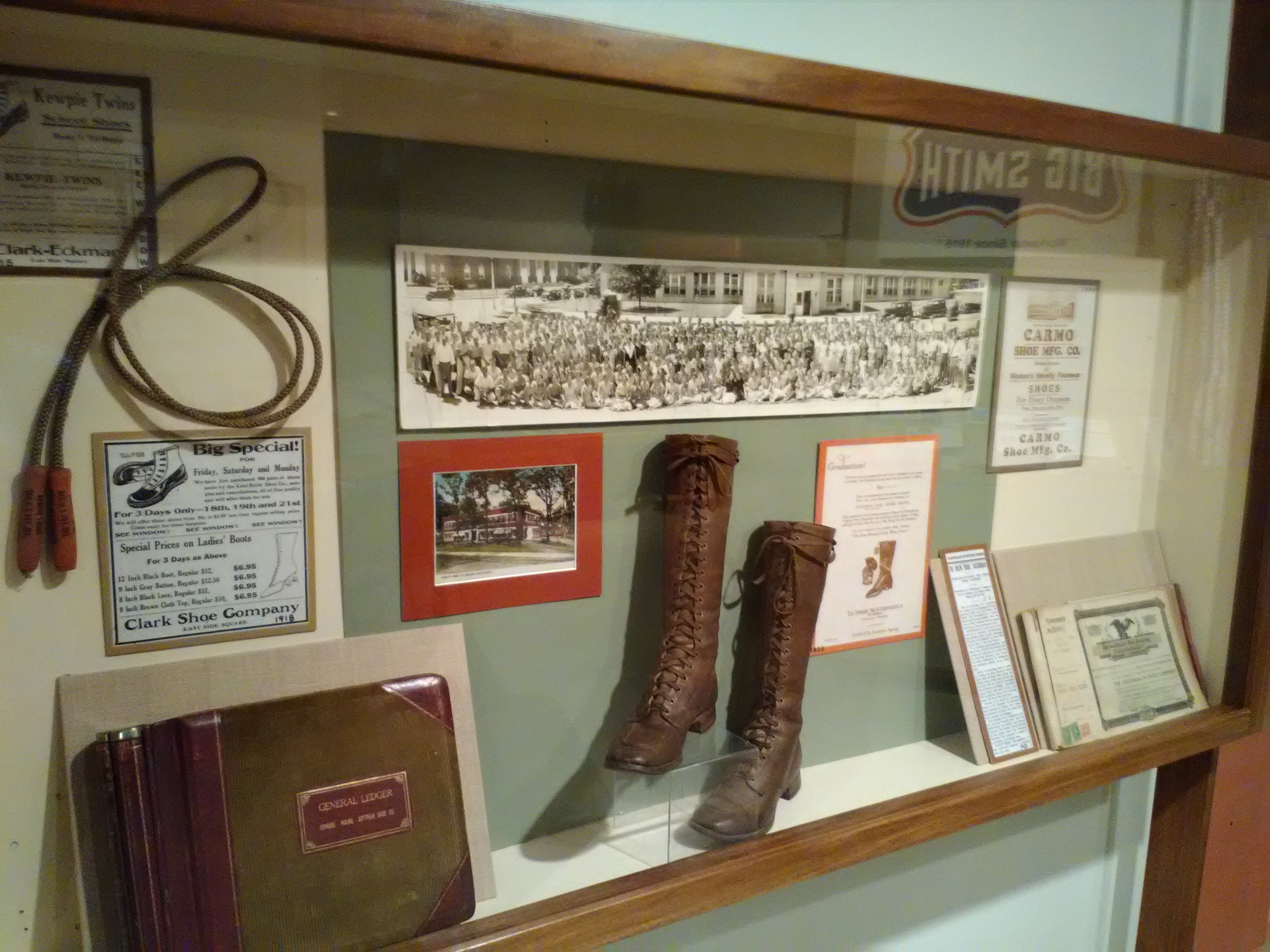 2017  Carthage, Missouri, had a large shoe manufacturing industry in the 1910-30s. Today only one manufacturer remains (Justin Boots). This display showed products, advertising, photos and ledgers of some of the earlier shoe factories.
