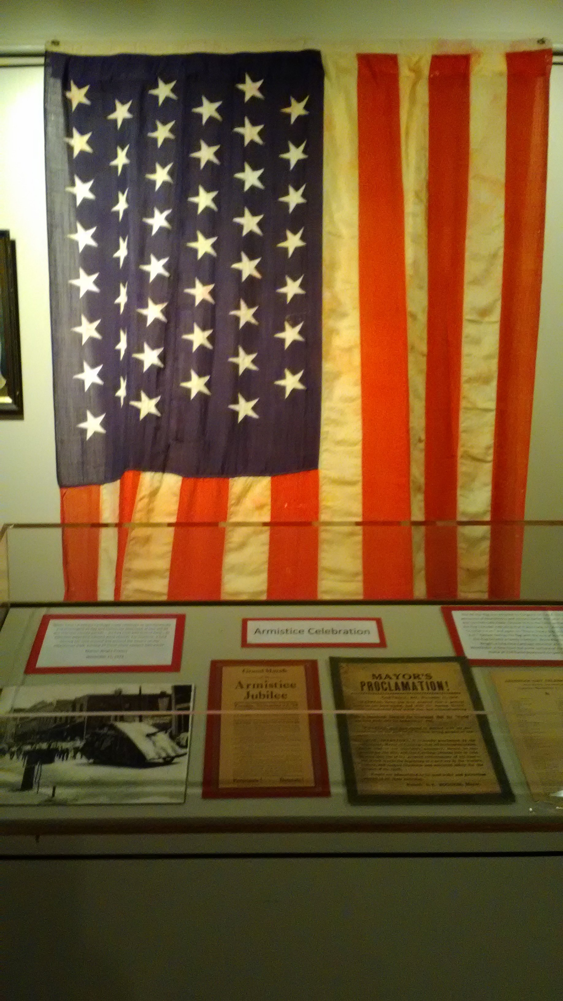 "2018-19  Wright-Powers family flag hung at the Powers Home for the 1918 armistice and the 1919 signing of the Treaty of Versailles. Part of ""Over here and over There"" exhibit."