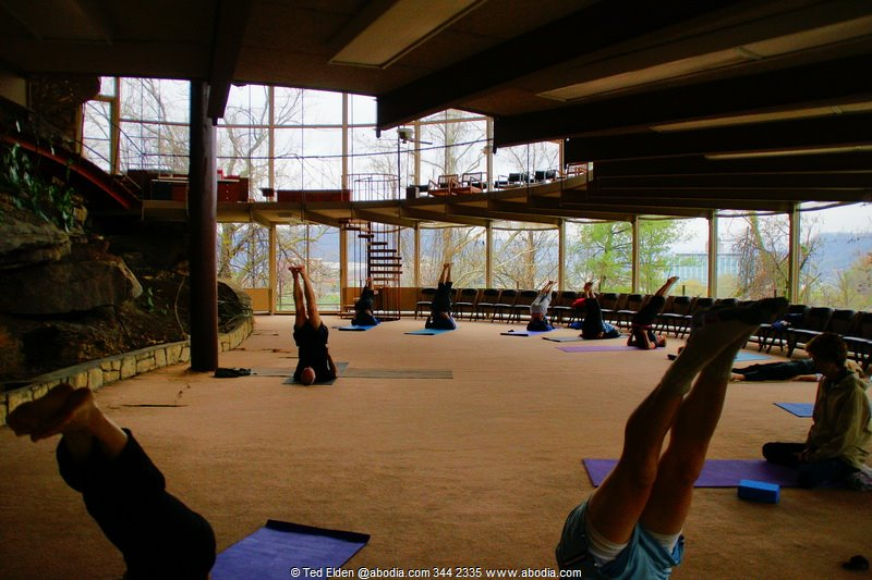 A yoga class provides a sense of scale to one of the circular rooms.