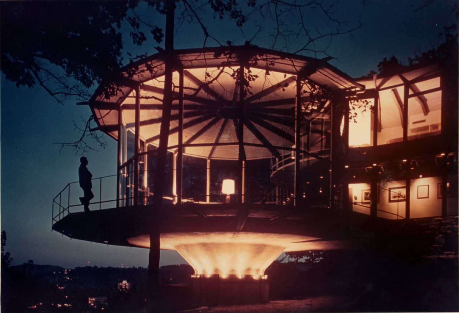 A nighttime view of one circular lounge.