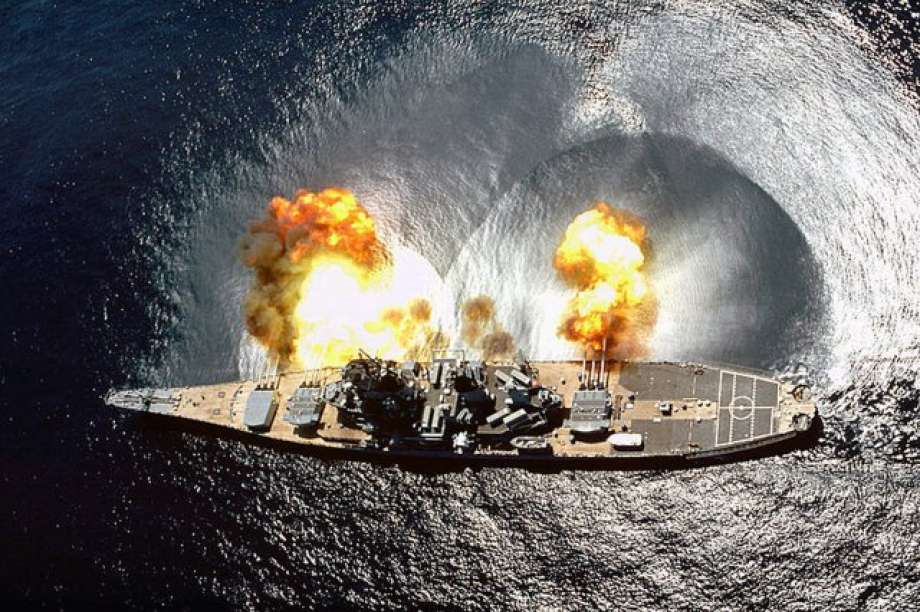 The arsenal's 16-inch guns shown in action from the USS Iowa.