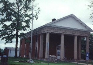 Front view of the Oak Hill Public Library. The plaque and column are visible in center foreground.