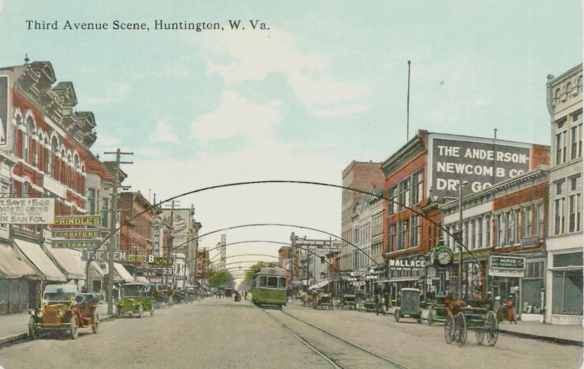 A vintage postcard depicting this block of 3rd Avenue prior to the addition the the Anderson-Newcomb Building.