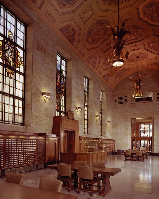 The library's Great Hall/foyer features a 42-foot vaulted ceiling, stained glass windows and its original reference desk.