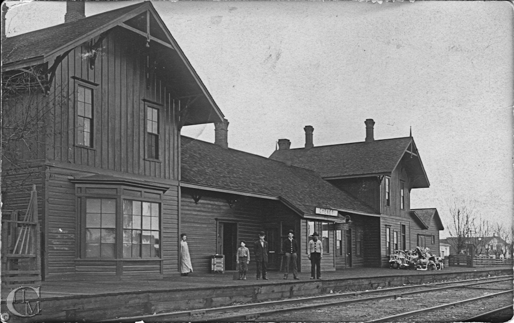 Postcard of Cheney's Northern Pacific Railway Station circa 1910. The postcard is addressed to Mr. Alex G. Watt of Cheney and identifies Floyd Watt as man 2nd from right. It is postmarked at Cheney on Feb. 2, 10am 1910 and has a 1 cent stamp.