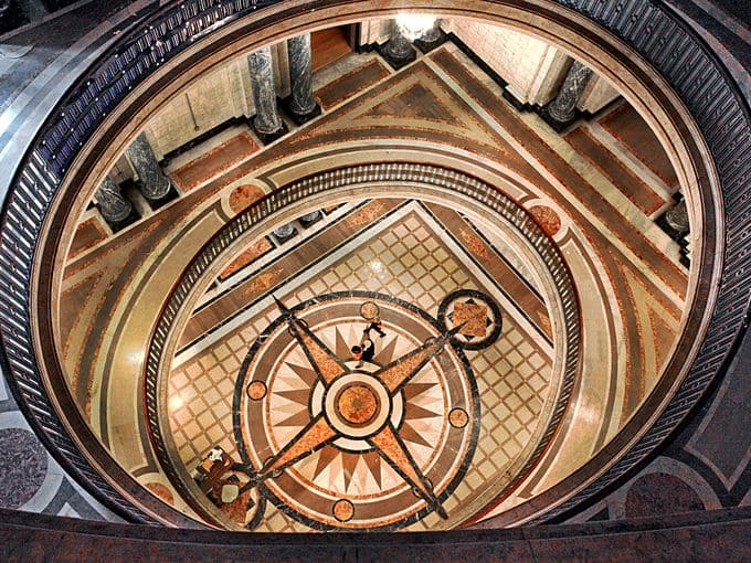 A view from the top of the 85-foot rotunda looking down on the inlaid compass rose.
