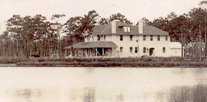 Photo of the inn soon after completion taken from across the lake.