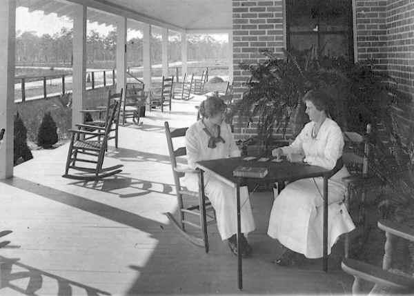 Two ladies enjoying the front porch of the Inn.