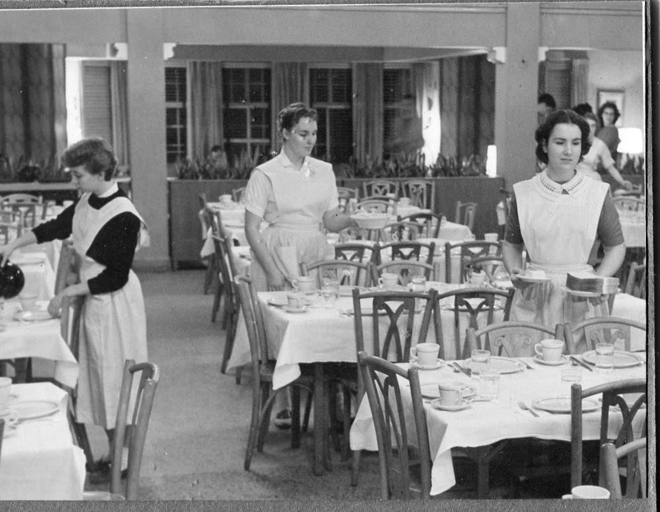 Students setting the tables before a meal