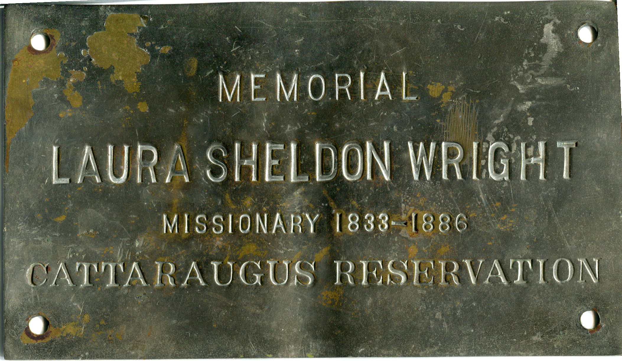 Memorial Plaque of Room 13. This Room was named in Memorial of  Laura Sheldon Wright, a missionary of the Cattaragus Reservation. Her sister, Ella, donated in her stead.