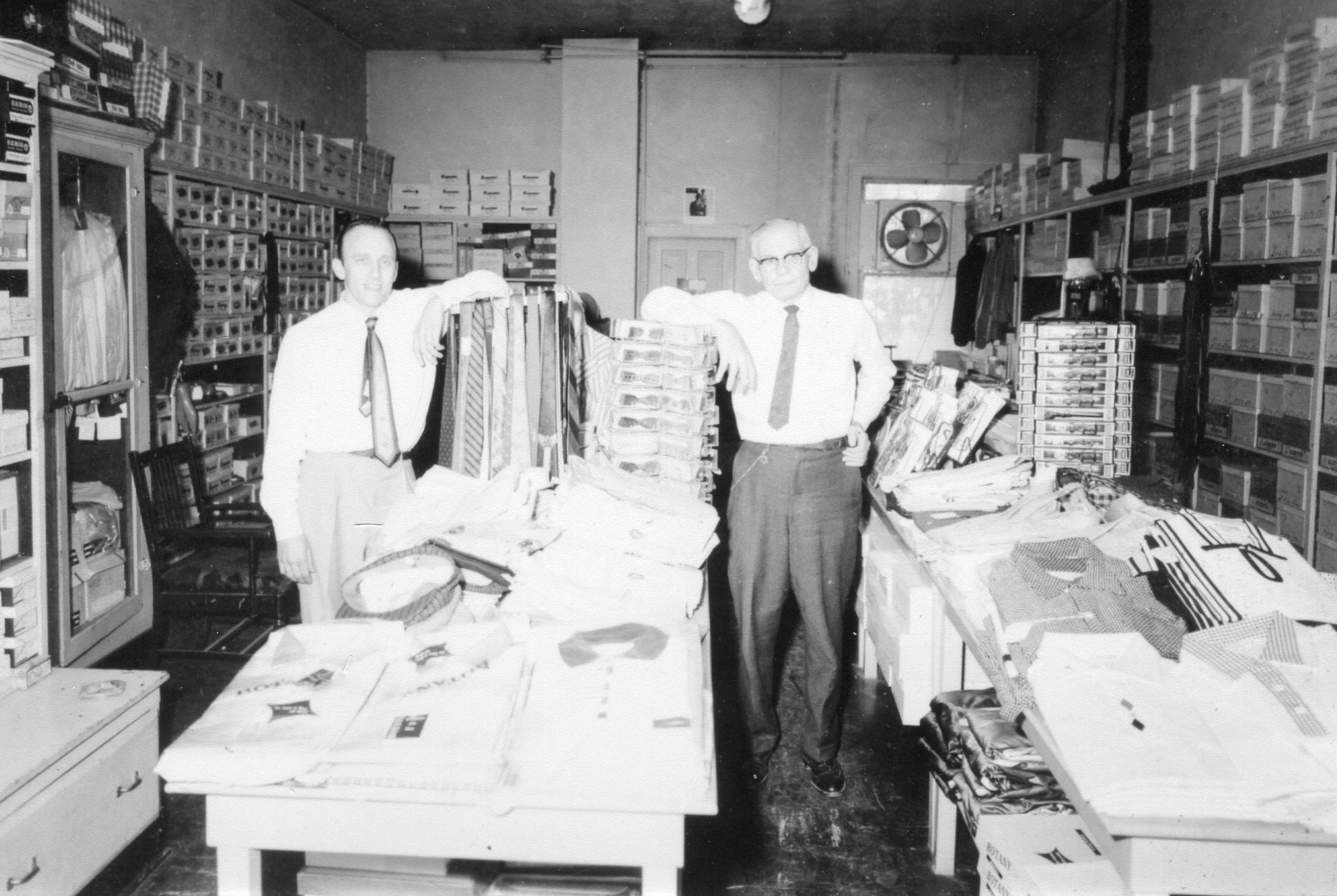 "Community Shop men's store at 107 Main Street. Ernie Scholberg, left, and ""Chick"" Hawley (owner), right."