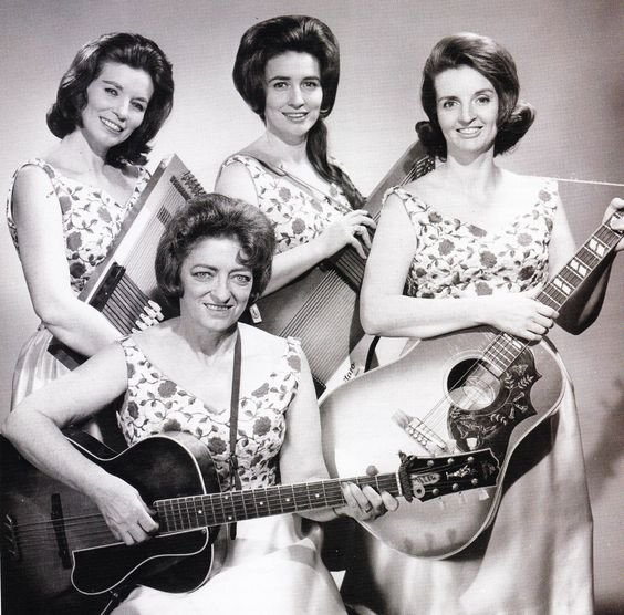 Mother Maybelle and the Carter Sisters. Front: Maybelle Carter. Back: Valerie June, Anita, and Helen Carter