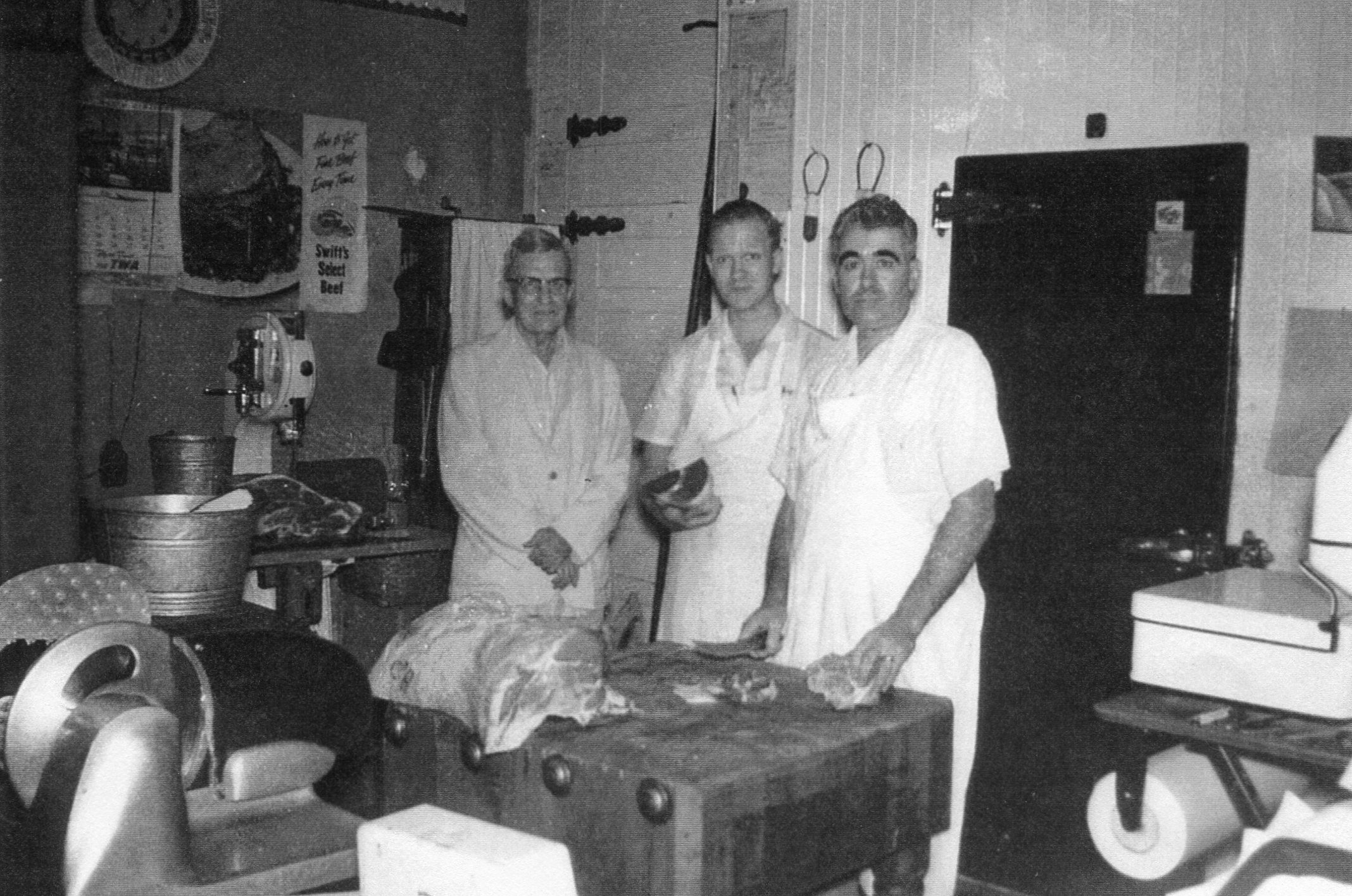 A view of the butcher's area inside Vawter's Super Market during the late 1950s. Pictured are Mr. Vawter, Bill Vawter, and Wilbur Williams.