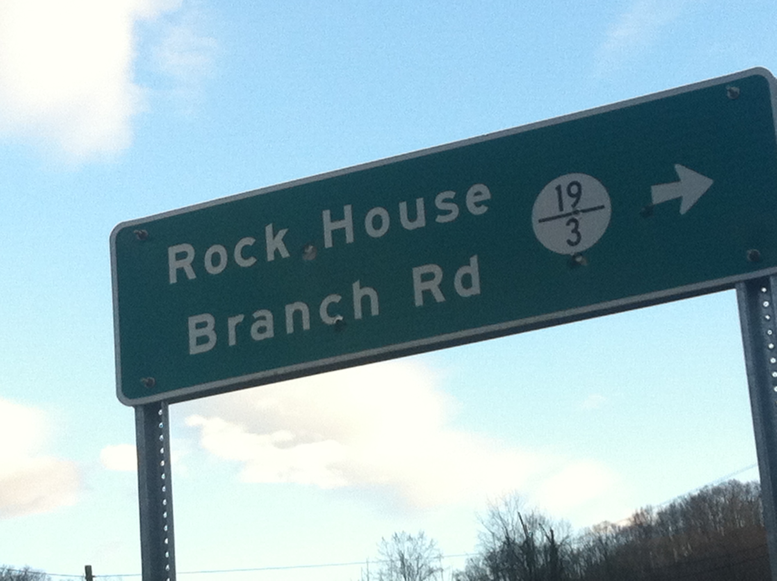 "Rockhouse Fork sign. Date: January 28, 2017. Photo by Brandon Kirk. Note: The sign erroneously designates the location ""Rock House Branch Rd."""