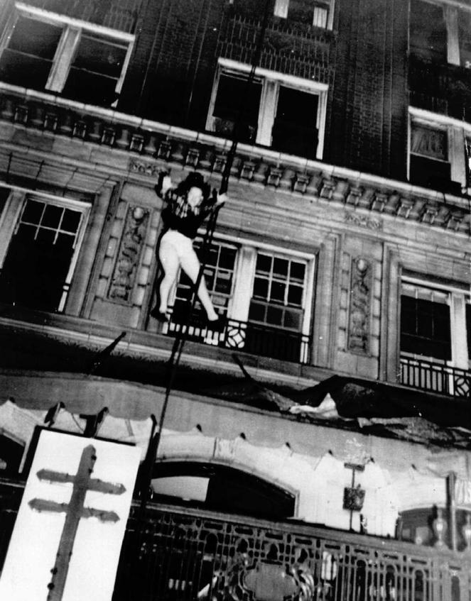 Photo by Arnold Hardy of daisy McCumber jumping from the building to escape the flames. She lived to the age of 86 according to Clio user James Hoadley.