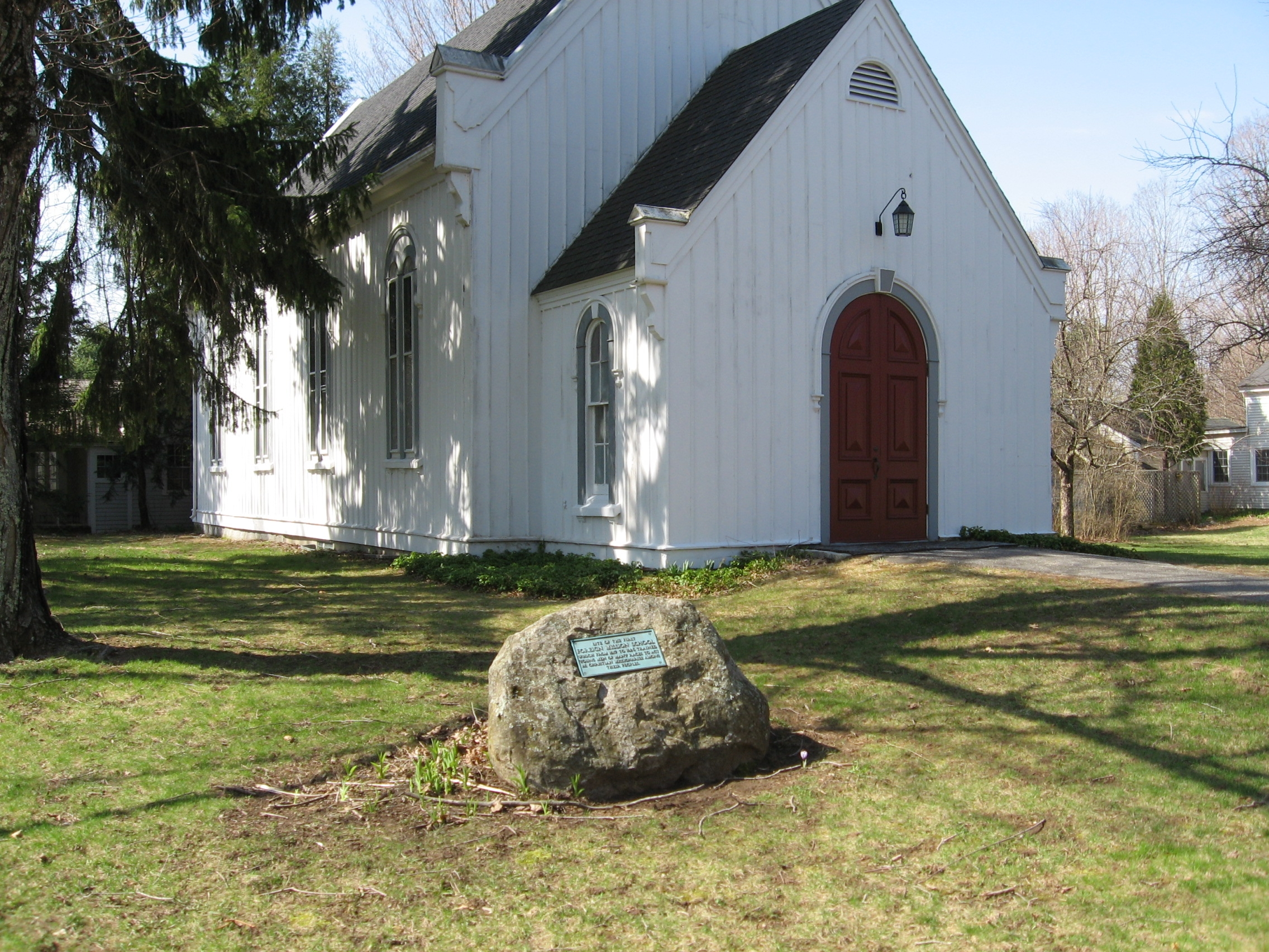 The site of the former school is designated by a small plaque on a rock outside of St. Peter's Lutheran Church. Photo by Michael Herrick, full photo credit below.