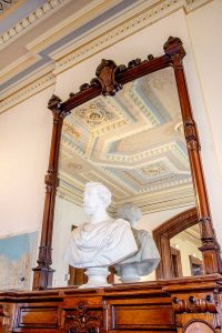 Billiards Room fireplace with bust of Charles D. Mathews