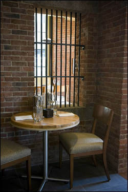Restored interior brick walls, now enjoyed in small seating areas.   Courtesy of The Boston Globe, http://archive.boston.com/business/gallery/Liberty_Hotel?pg=4