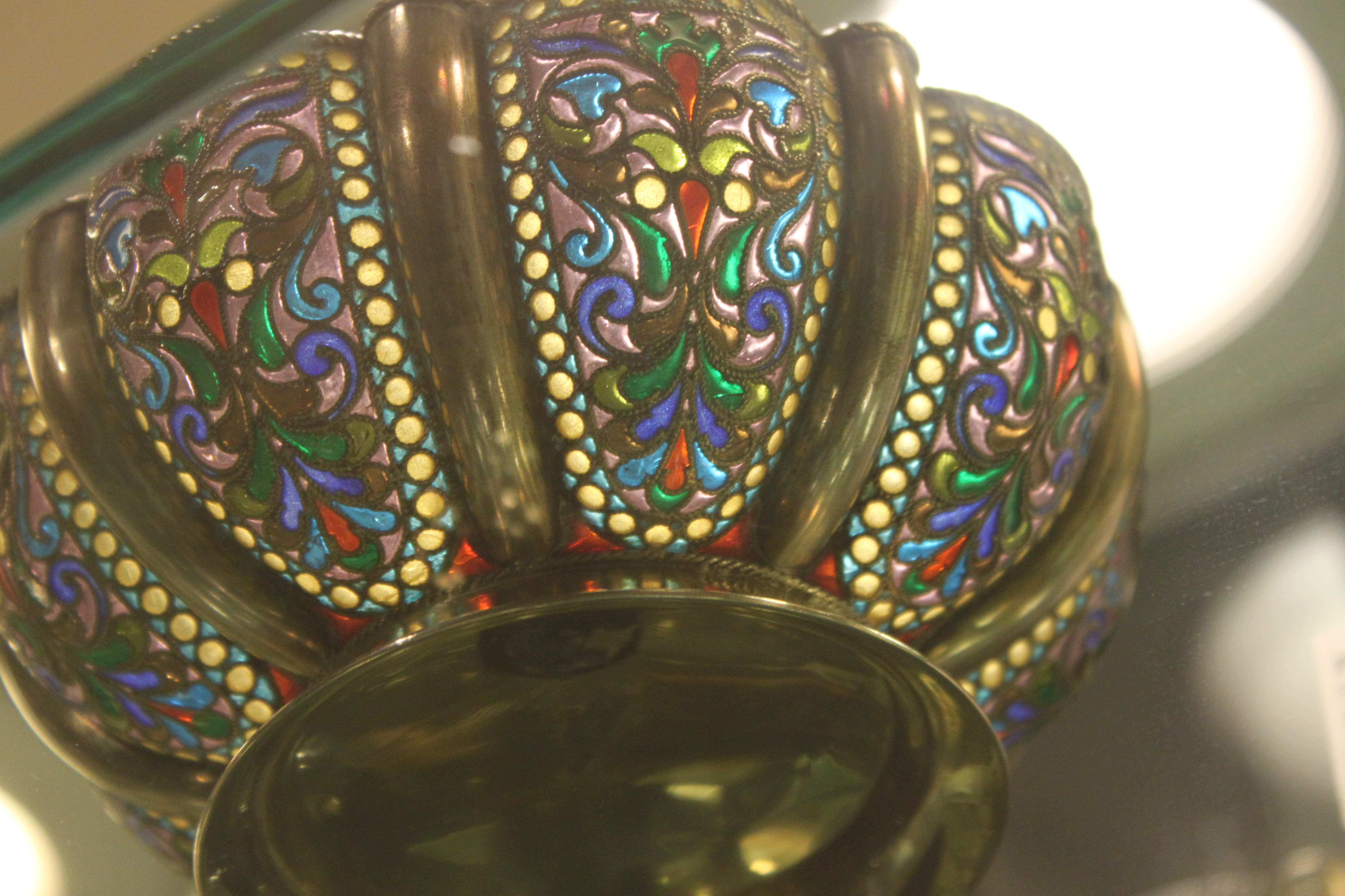 A filigree bowl of gold, silver and translucent enamel resembling stained glass purchased in Moscow.