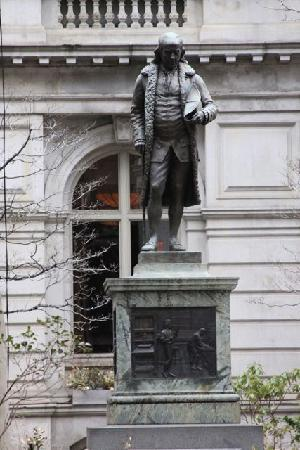 Statue of Benjamin Franklin, who attended the school before dropping out to do his studies independently.