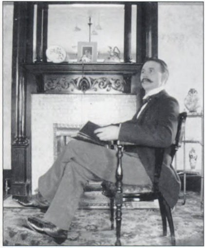 Edwin A. Durham posing in his Sistersville home