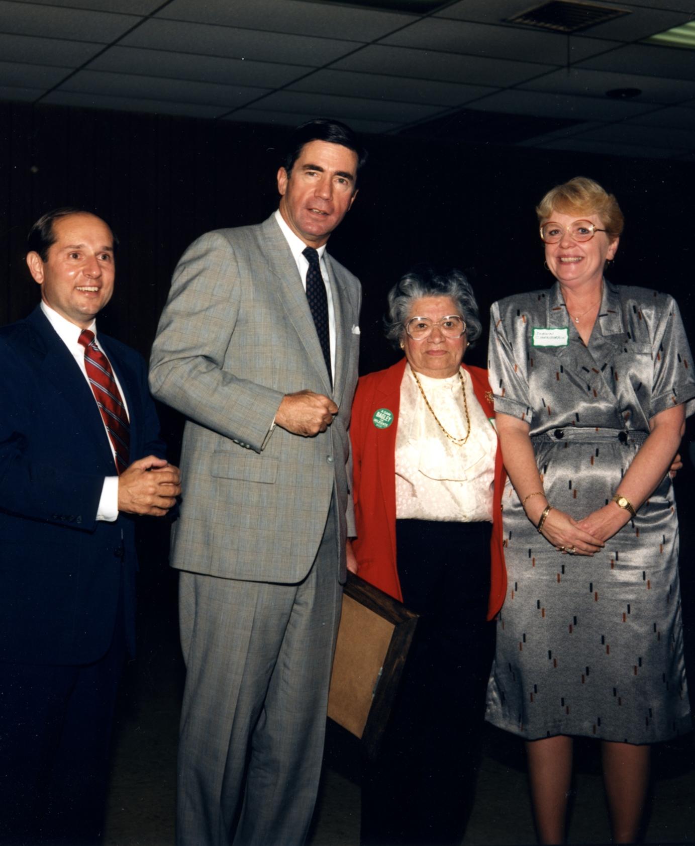 "Providencia Gonzalez with Governor Charles S. ""Chuck"" Robb, photograph courtesy of Providencia Gonzalez."