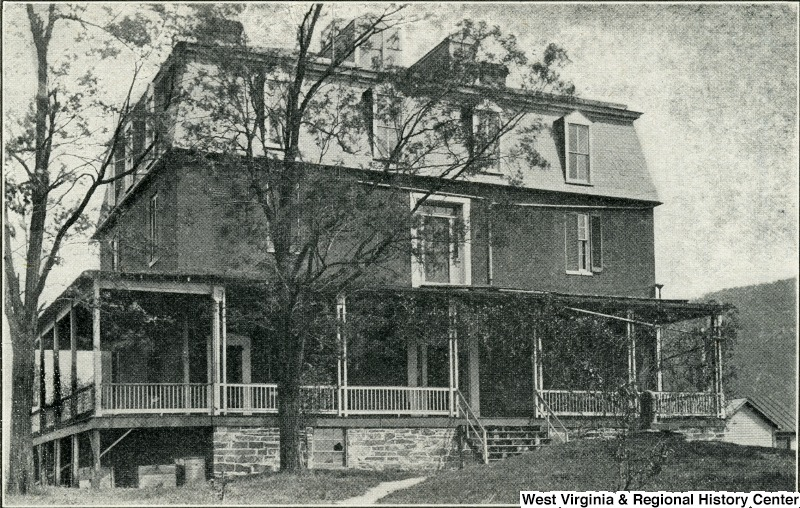 Lockwood House in 1958 with its third floor. Image obtained from the Storer College Digital Collection.