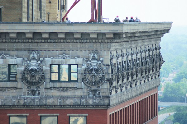 A close-up of the building's crown which features ornate terra cotta moldings.