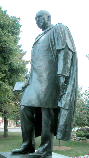 Statue by Myra Reynolds Richards honoring James Whitcomb Riley on courthouse lawn in Greenfield, Indiana.