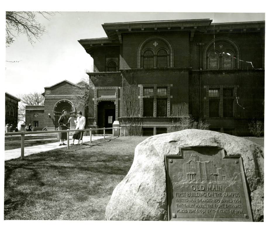 Shevlin Hall in 1954, with a plaque commemorating Old Main