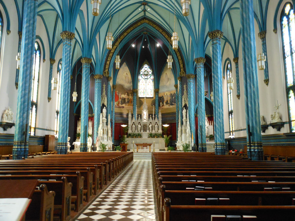 Interior view of the church showing the blue colors on the columns. Photo: Christine M. Grote. https://randomthoughtsfrommidlife.files.wordpress.com/2012/07/14-st_xavier-2012-07-11.jpg