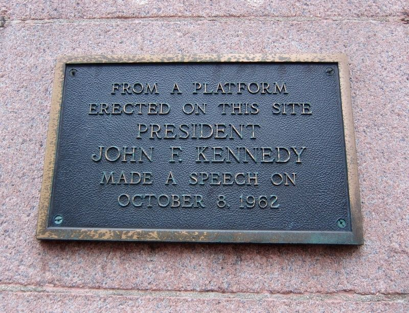 The plaque is located at 100 E 5th street near the entrance to Fountain News.