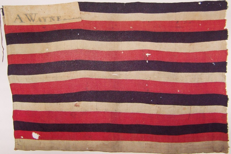 "This flag, presented to Miami chief She-Moc-E-Nish at the Treaty of Greenville, is signed ""A.Wayne commander in chief"". It is currently owned by the State of Indiana."