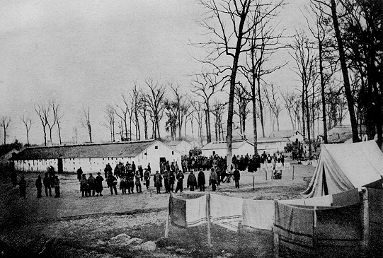 View inside prison at Camp Morton near Indianapolis, Indiana, the summer and autumn of 1864. Note substantial and comfortable barracks Source: Prisoners of War, 1861-65