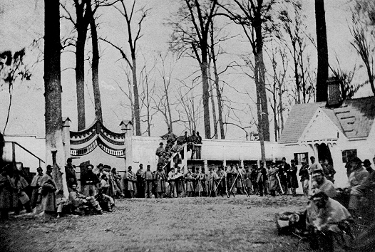 Guard and Guard-house at Camp Morton near Indianapolis, Indiana. The 60th Regiment Massachusetts Veteran Volunteers on guard. August to November, 1864. Source: Prisoners of War, 1861-65