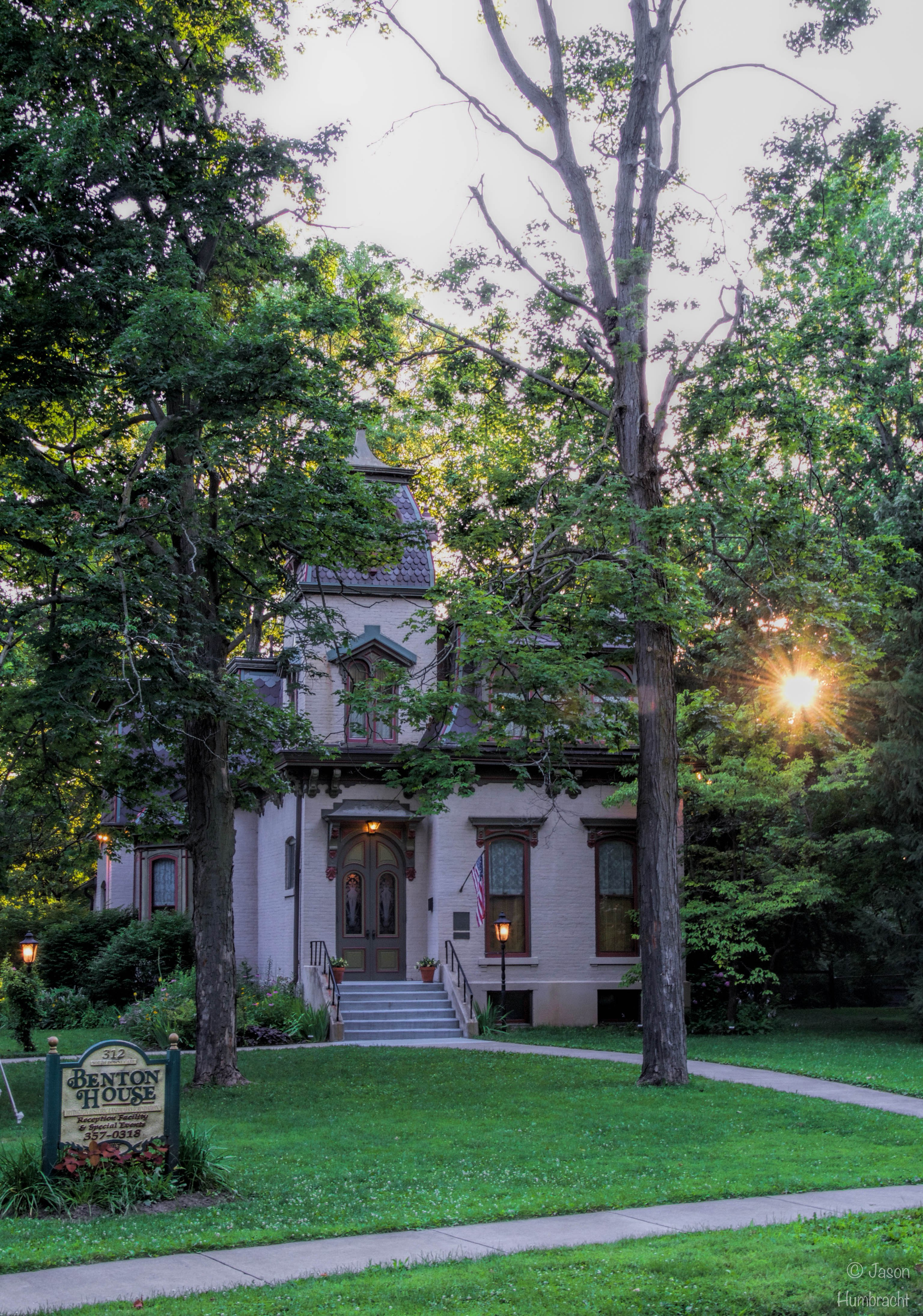 The sun sets behind the 1873 Benton House.
