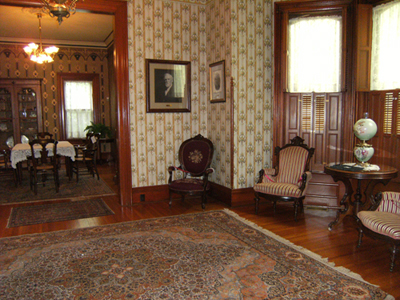The Benton House's front parlor with a glimpse of the dining room next door.