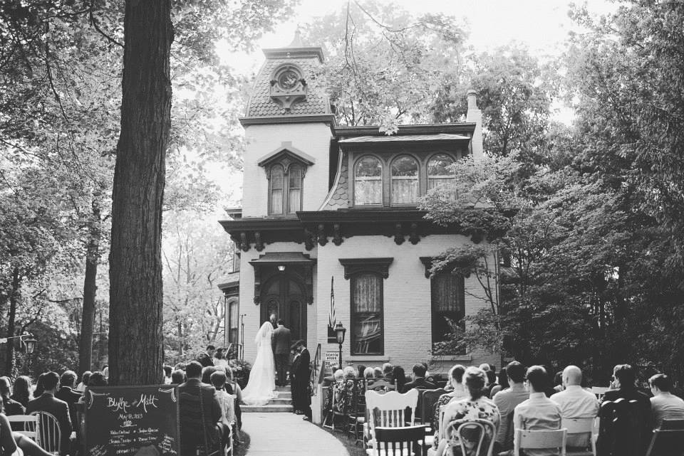 A couple is married on the steps of the Benton House.