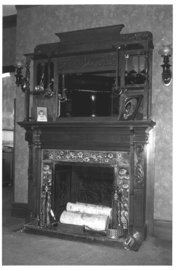 Inside the house, view of the fireplace, photographed by David Ransom