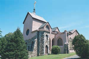 The exterior walls feature rubble stone (lower half) and stucco (upper half). (source: Archdiocese of Hartford)
